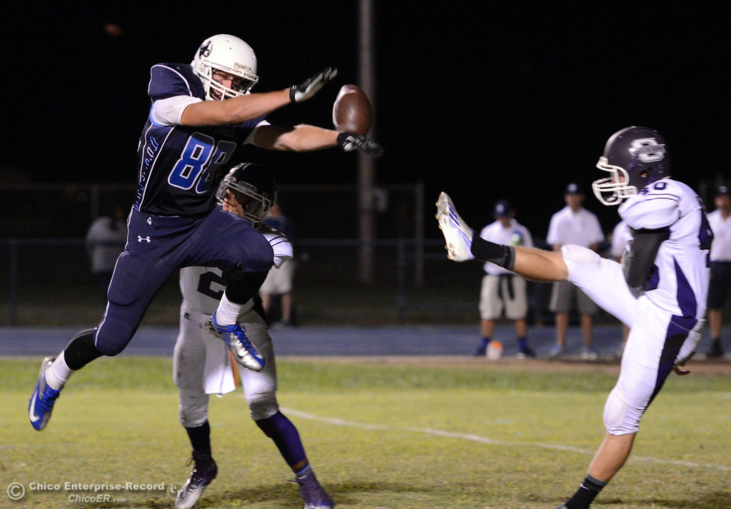 Description of . Pleasant Valley High\'s #88 Zack Suttles (left) blocks a punt against Oroville High\'s #40 Taner Dubie (right) in the second quarter of their football game at PVHS Asgard Yard Friday, September 20, 2013, in Chico, Calif. (Jason Halley/Chico Enterprise-Record)