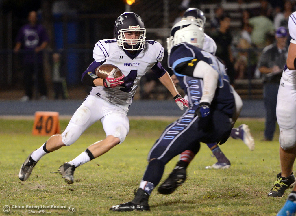 Description of . Pleasant Valley High\'s #34 Cale Crawford (right) defends against Oroville High\'s #4 Antony Ramsey (left) who rushes in the first quarter of their football game at PVHS Asgard Yard Friday, September 20, 2013, in Chico, Calif. (Jason Halley/Chico Enterprise-Record)