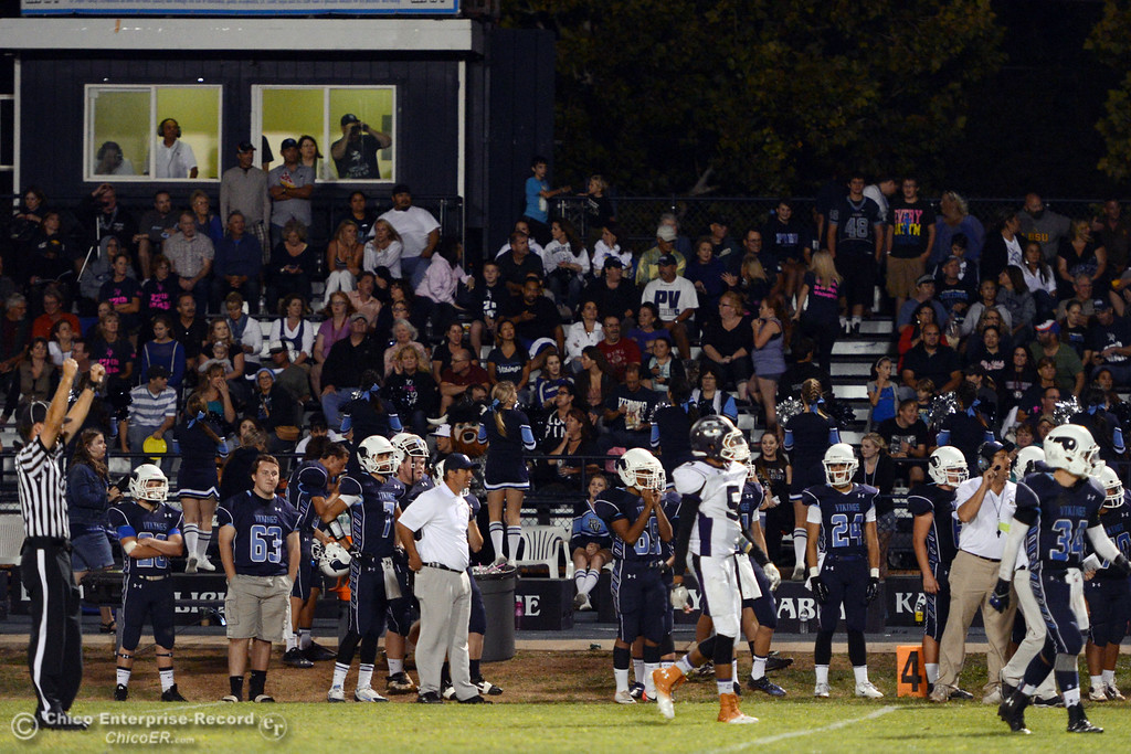 Description of . Pleasant Valley High sidelines look on against Oroville High in the third quarter of their football game at PVHS Asgard Yard Friday, September 20, 2013, in Chico, Calif. (Jason Halley/Chico Enterprise-Record)