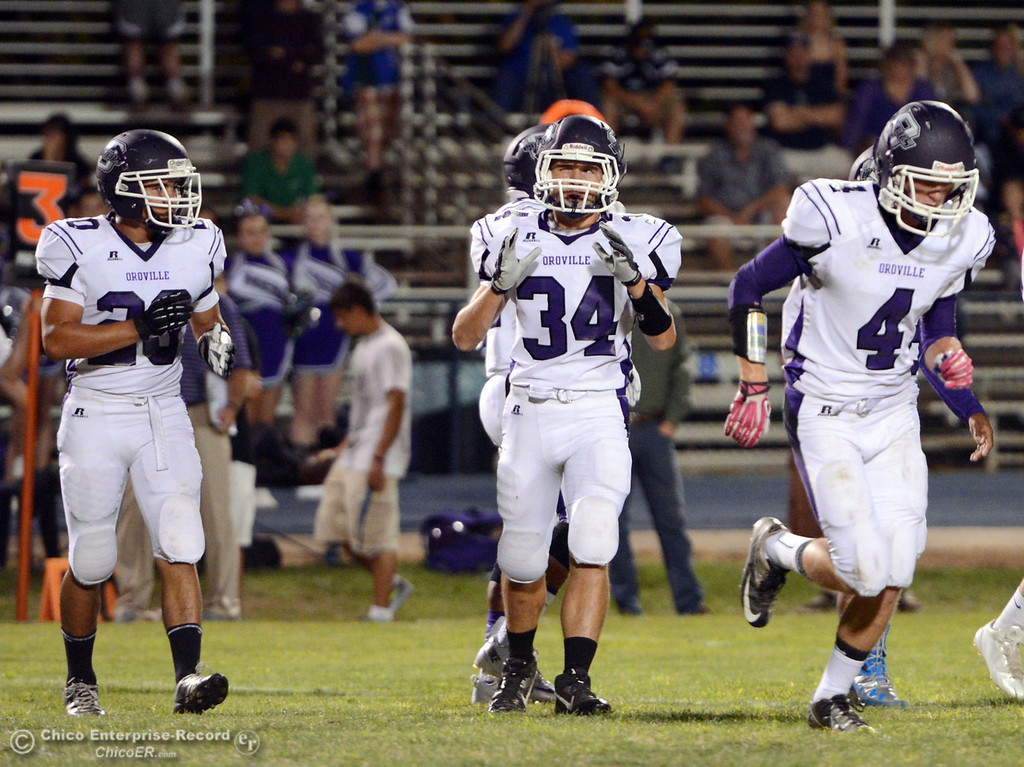 Description of . Pleasant Valley High against Oroville High\'s #20 Brandon Tewksbury (left) #34 Thomas Miller (center) and 34 Antony Ramsey (right) in the first quarter of their football game at PVHS Asgard Yard Friday, September 20, 2013, in Chico, Calif. (Jason Halley/Chico Enterprise-Record)