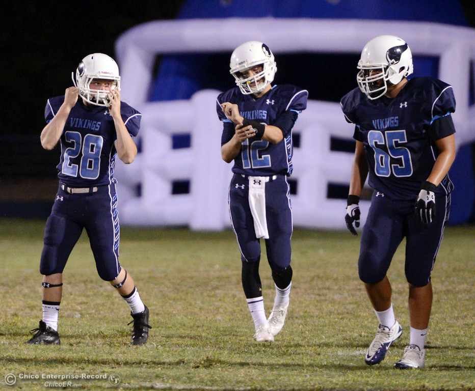 Description of . Pleasant Valley High\'s #28 Dylan Batie, #12 Trent Darms and #65 Michael Walker (left to right) prepare against Oroville High in the first quarter of their football game at PVHS Asgard Yard Friday, September 20, 2013, in Chico, Calif. (Jason Halley/Chico Enterprise-Record)