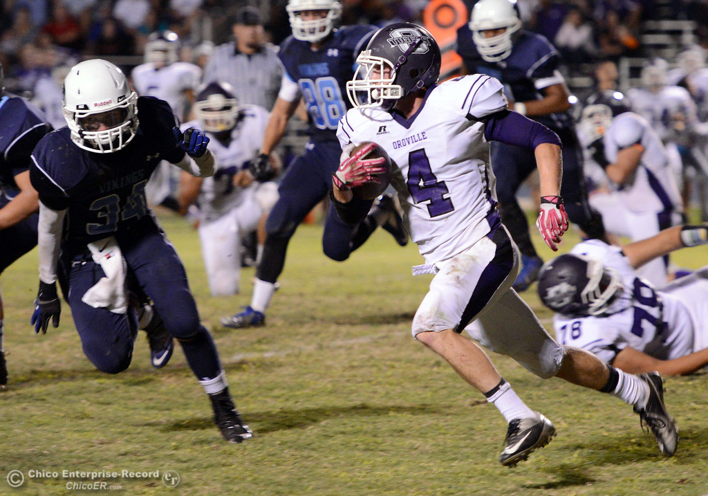 Description of . Oroville High\'s #4 Antony Ramsey (right) rushes against Pleasant Valley High\'s #34 Cale Crawford (left) in the second quarter of their football game at PVHS Asgard Yard Friday, September 20, 2013, in Chico, Calif. (Jason Halley/Chico Enterprise-Record)