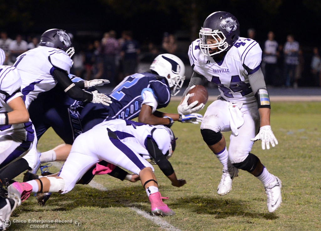 Description of . Pleasant Valley High against Oroville High\'s #44 Derek Gordon (right) rushes in the third quarter of their football game at PVHS Asgard Yard Friday, September 20, 2013, in Chico, Calif. (Jason Halley/Chico Enterprise-Record)