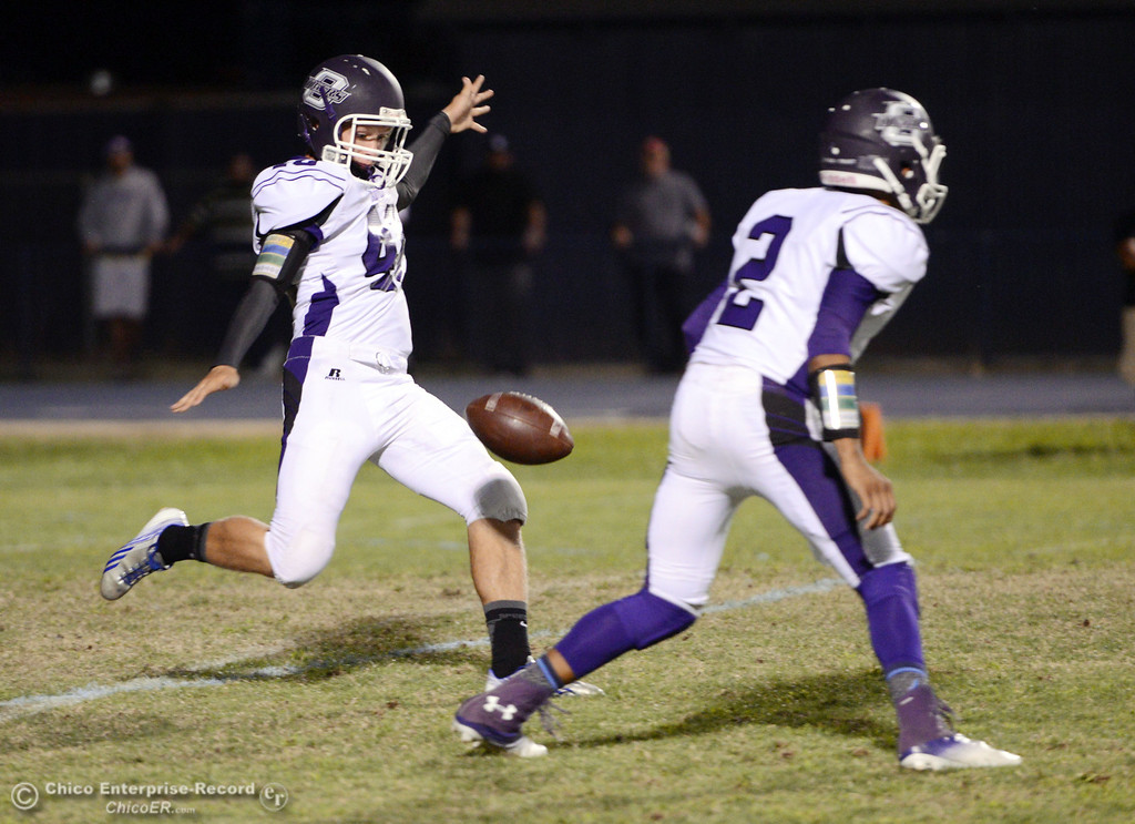 Description of . Pleasant Valley High against Oroville High\'s #40 Tanner Dubie (left) punts away in the first quarter of their football game at PVHS Asgard Yard Friday, September 20, 2013, in Chico, Calif. (Jason Halley/Chico Enterprise-Record)