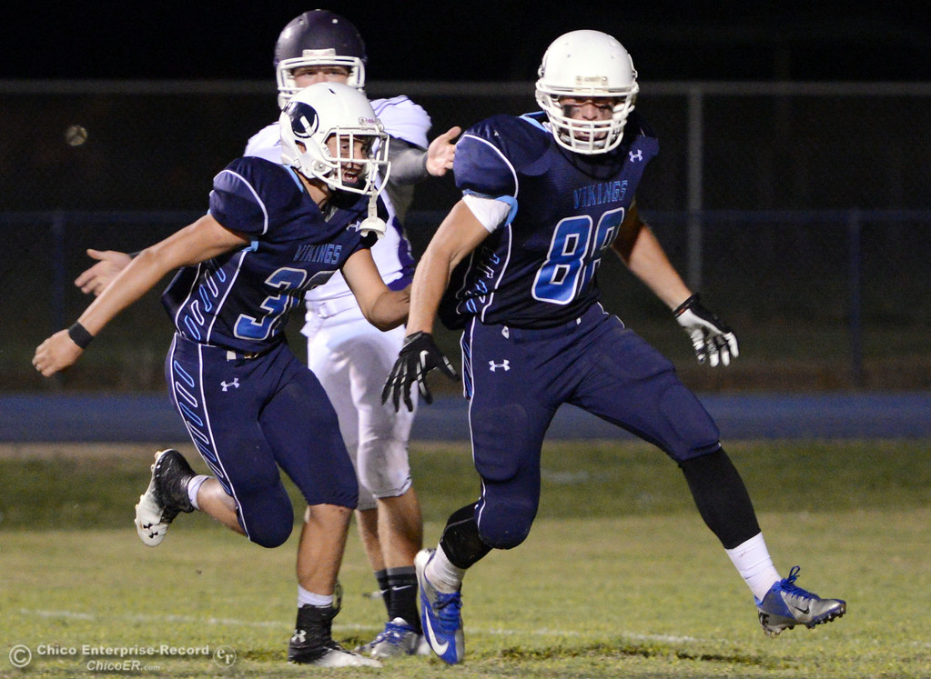 Description of . Pleasant Valley High\'s #30 Connor Melton (left) reacts with #88 Zack Suttles (right) who blocked a punt against Oroville High in the second quarter of their football game at PVHS Asgard Yard Friday, September 20, 2013, in Chico, Calif. (Jason Halley/Chico Enterprise-Record)