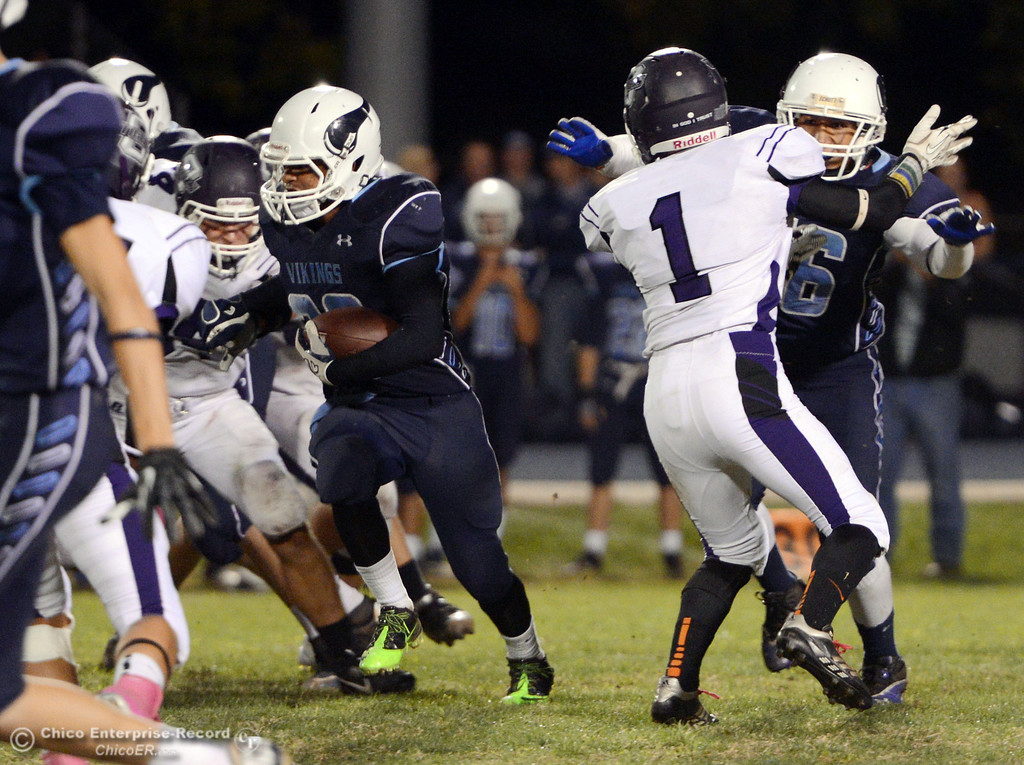 Description of . Pleasant Valley High\'s #20 Bryan Esquivel rushes against Oroville High in the fourth quarter of their football game at PVHS Asgard Yard Friday, September 20, 2013, in Chico, Calif. (Jason Halley/Chico Enterprise-Record)