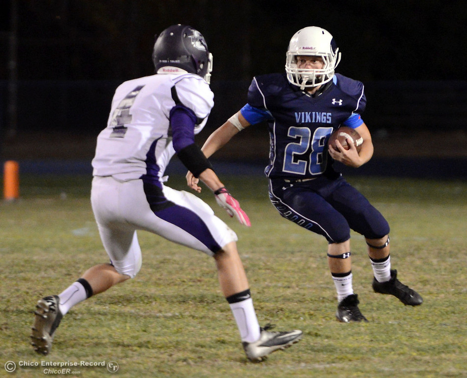 Description of . Pleasant Valley High\'s #28 Dylan Batie (right) rushes against Oroville High\'s #4 Antony Ramsey (left) in the first quarter of their football game at PVHS Asgard Yard Friday, September 20, 2013, in Chico, Calif. (Jason Halley/Chico Enterprise-Record)