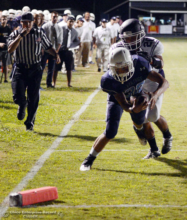 Description of . Pleasant Valley High\'s #30 Connor Melton (front) rushes for a touchdown against Oroville High\'s #20 Brandon Tewksbury (back) in the second quarter of their football game at PVHS Asgard Yard Friday, September 20, 2013, in Chico, Calif. (Jason Halley/Chico Enterprise-Record)