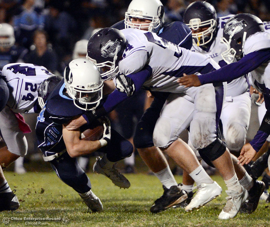 Description of . Pleasant Valley Highs\' #44 Cylan Leitner (left) is tackled against Oroville High\'s #54 Kory Stenberg (right) in the third quarter of their football game at PVHS Asgard Yard Friday, September 20, 2013, in Chico, Calif. (Jason Halley/Chico Enterprise-Record)