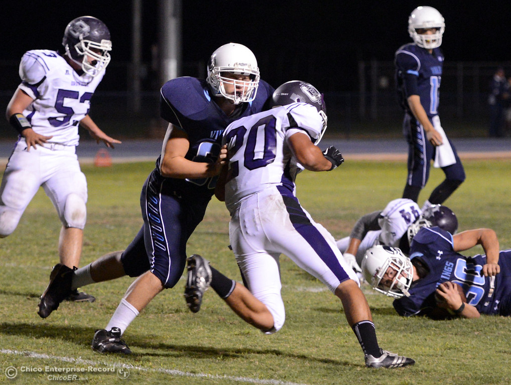 Description of . Pleasant Valley High\'s #68 Jacob Gregg (left) lays a block against Oroville High\'s #20 Brandon Tewksbury (right) in the first quarter of their football game at PVHS Asgard Yard Friday, September 20, 2013, in Chico, Calif. (Jason Halley/Chico Enterprise-Record)