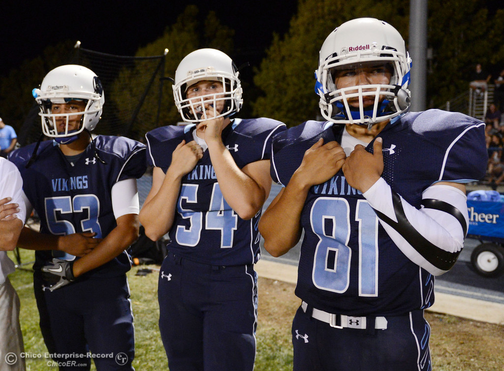 Description of . Pleasant Valley High\'s #53 Christian Miranda, #54 Zack Gillam, and #81 Brian Lerch (left to right) against Oroville High in the second quarter of their football game at PVHS Asgard Yard Friday, September 20, 2013, in Chico, Calif. (Jason Halley/Chico Enterprise-Record)