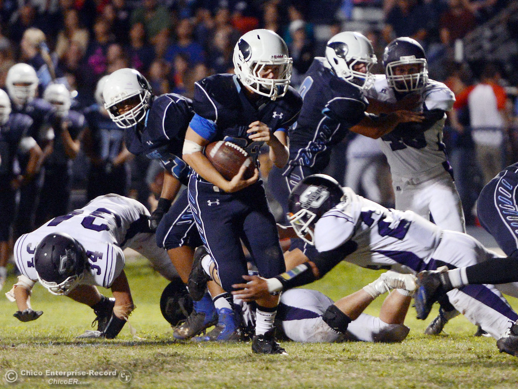 Description of . Pleasant Valley High\'s #28 Dylan Batie (left) rushes against Oroville High in the third quarter of their football game at PVHS Asgard Yard Friday, September 20, 2013, in Chico, Calif. (Jason Halley/Chico Enterprise-Record)