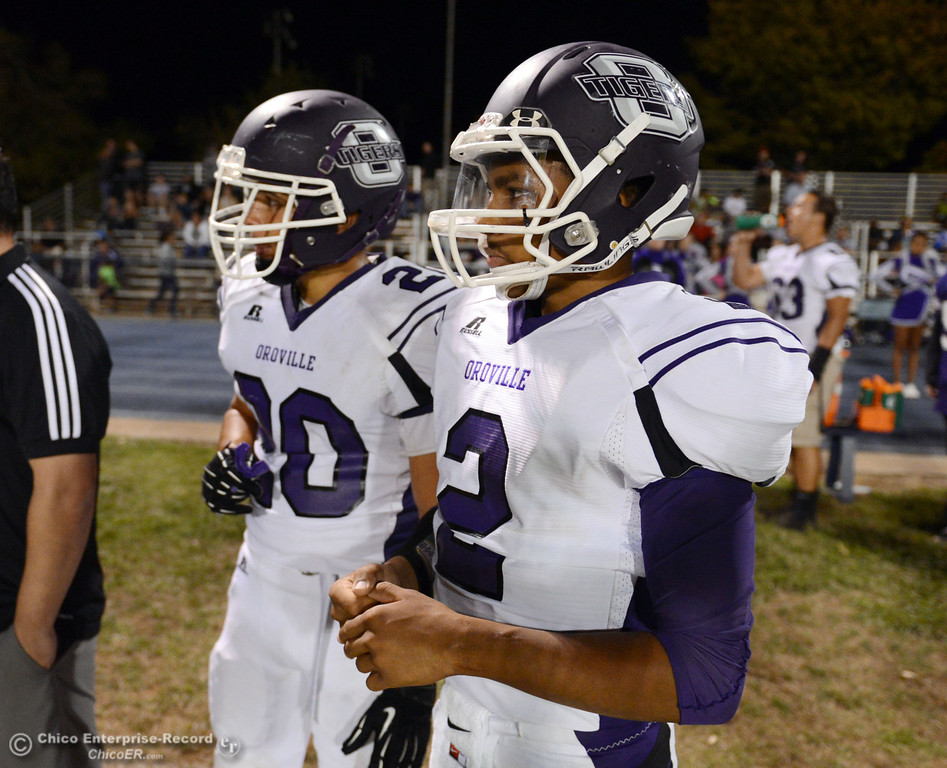 Description of . Oroville High\'s #20 Brandon Tewksbury (left) and #2 Marcus Wilhite (right) against Pleasant Valley High in the fourth quarter of their football game at PVHS Asgard Yard Friday, September 20, 2013, in Chico, Calif. (Jason Halley/Chico Enterprise-Record)