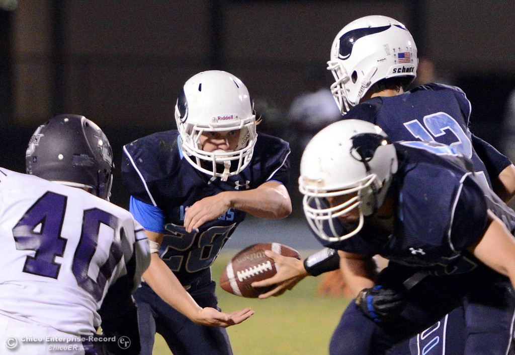 . Pleasant Valley High\'s #28 Dylan Batie (left) receives the handoff from #12 Trent Darms (right) rushes against Oroville High in the second quarter of their football game at PVHS Asgard Yard Friday, September 20, 2013, in Chico, Calif. (Jason Halley/Chico Enterprise-Record)