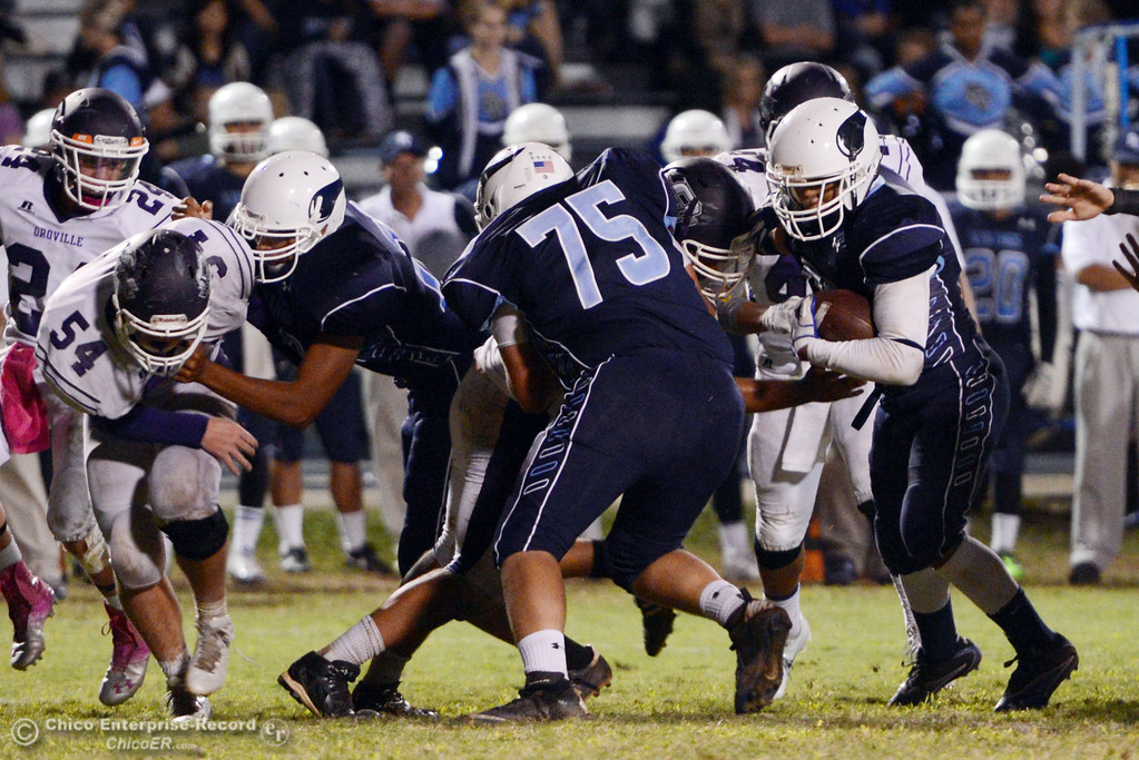 Description of . Pleasant Valley High\'s #56 (right)  against Oroville High in the fourth quarter of their football game at PVHS Asgard Yard Friday, September 20, 2013, in Chico, Calif. (Jason Halley/Chico Enterprise-Record)