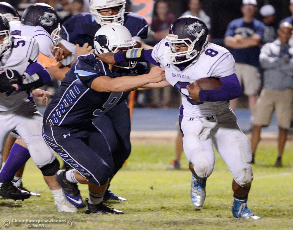 Description of . Pleasant Valley High\'s #9 Houston McGowan (left) tackles against Oroville High\'s #8 James Jones (right) in the second quarter of their football game at PVHS Asgard Yard Friday, September 20, 2013, in Chico, Calif. (Jason Halley/Chico Enterprise-Record)