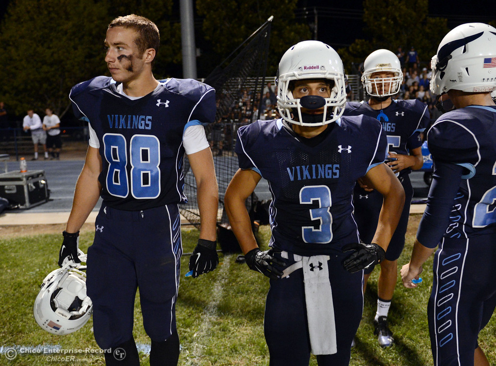 Description of . Pleasant Valley High\'s #88 Zack Suttles (left) and #3 Brandon Romero (right) against Oroville High in the second quarter of their football game at PVHS Asgard Yard Friday, September 20, 2013, in Chico, Calif. (Jason Halley/Chico Enterprise-Record)