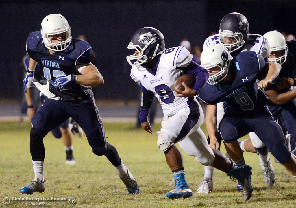 Description of . Pleasant Valley High\'s #42 Chad Olsen (left) and #9 Houston McGowan (right) defend against Oroville High\'s #8 James Jones (center) in the second quarter of their football game at PVHS Asgard Yard Friday, September 20, 2013, in Chico, Calif. (Jason Halley/Chico Enterprise-Record)