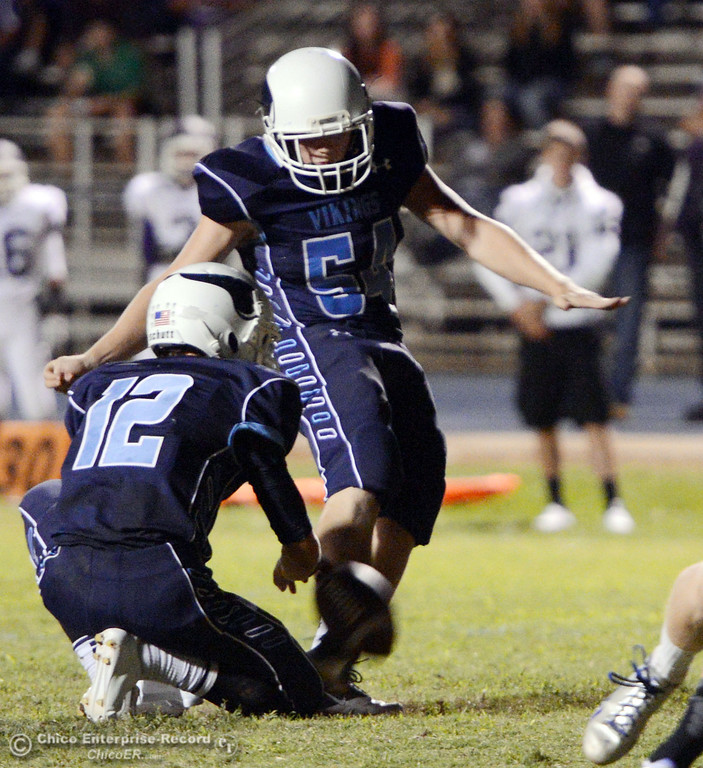 Description of . Pleasant Valley High\'s #54 Zack Gillam (right) kicks the extra point on against Oroville High in the second quarter of their football game at PVHS Asgard Yard Friday, September 20, 2013, in Chico, Calif. (Jason Halley/Chico Enterprise-Record)