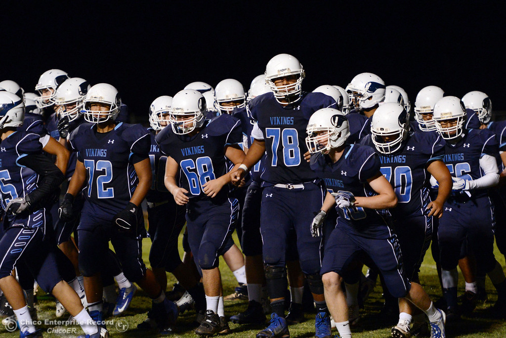 Description of . Pleasant Valley High team takes the field against Oroville High in the third quarter of their football game at PVHS Asgard Yard Friday, September 20, 2013, in Chico, Calif. (Jason Halley/Chico Enterprise-Record)