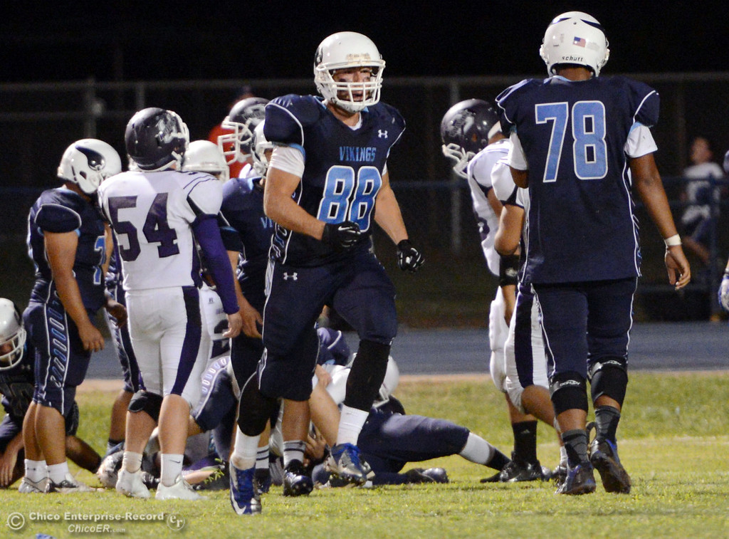 Description of . Pleasant Valley High\'s #88 Zack Suttles (center) against Oroville High in the second quarter of their football game at PVHS Asgard Yard Friday, September 20, 2013, in Chico, Calif. (Jason Halley/Chico Enterprise-Record)