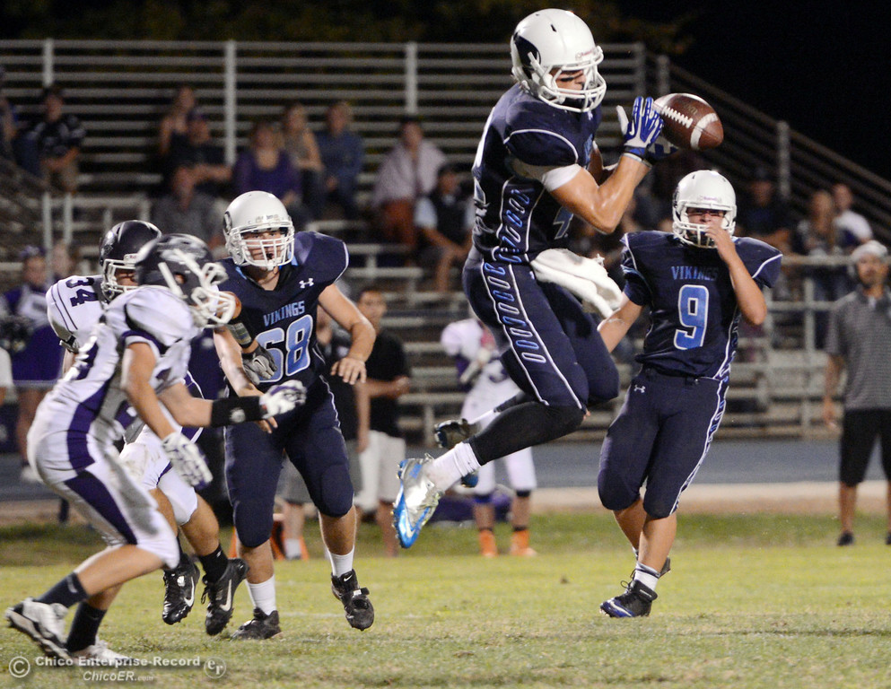 Description of . Pleasant Valley High\'s #42 Chad Olsen (center) completes a catch against Oroville High in the first quarter of their football game at PVHS Asgard Yard Friday, September 20, 2013, in Chico, Calif. (Jason Halley/Chico Enterprise-Record)