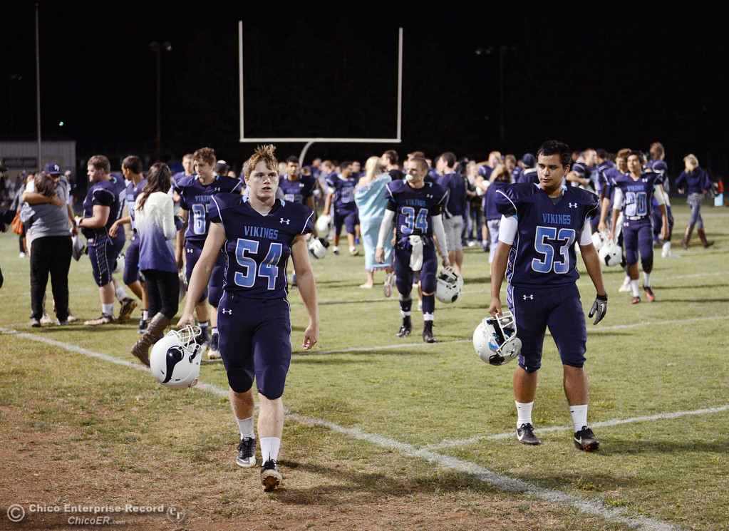 Description of . Pleasant Valley High #54 Zack Gillam (left) and Christian Miranda (right) celebrates their win against Oroville High in their football game at PVHS Asgard Yard Friday, September 20, 2013, in Chico, Calif. (Jason Halley/Chico Enterprise-Record)