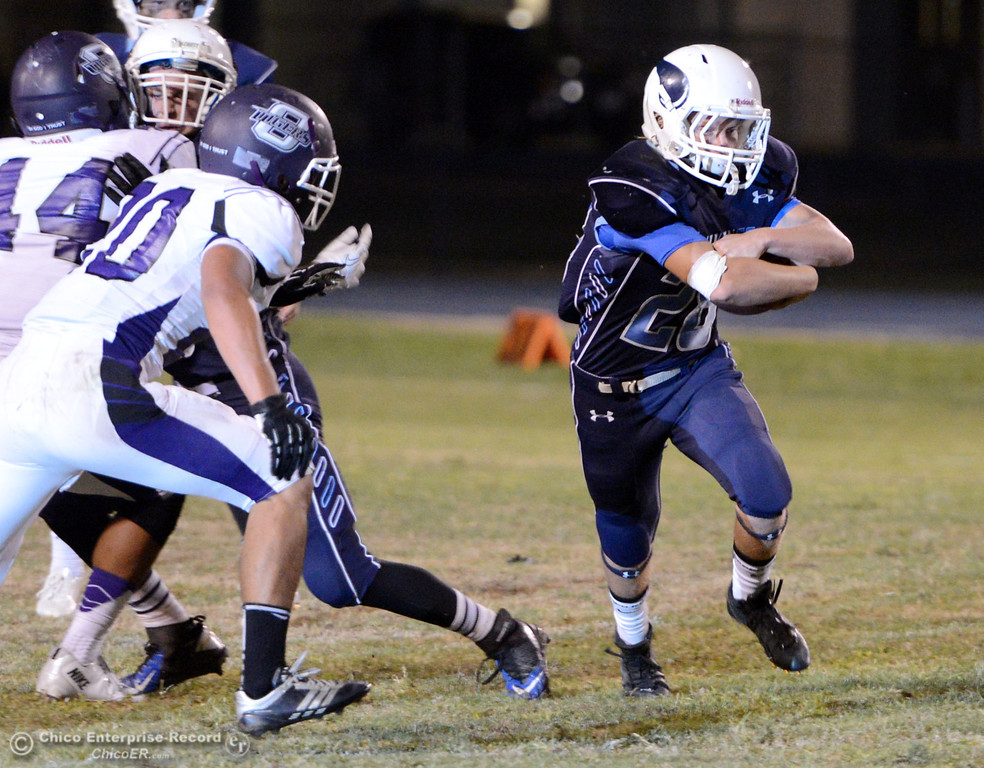 Description of . Pleasant Valley High\'s #28 Dylan Batie (right) rushes against Oroville High in the second quarter of their football game at PVHS Asgard Yard Friday, September 20, 2013, in Chico, Calif. (Jason Halley/Chico Enterprise-Record)