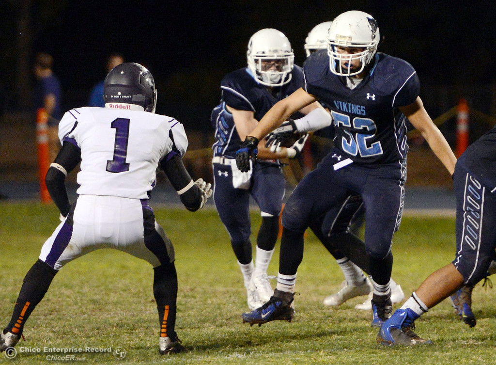 Description of . Pleasant Valley High\'s #52 Riley Andrew (right) blocks against Oroville High\'s #1 Michael Ripley (left) in the third quarter of their football game at PVHS Asgard Yard Friday, September 20, 2013, in Chico, Calif. (Jason Halley/Chico Enterprise-Record)