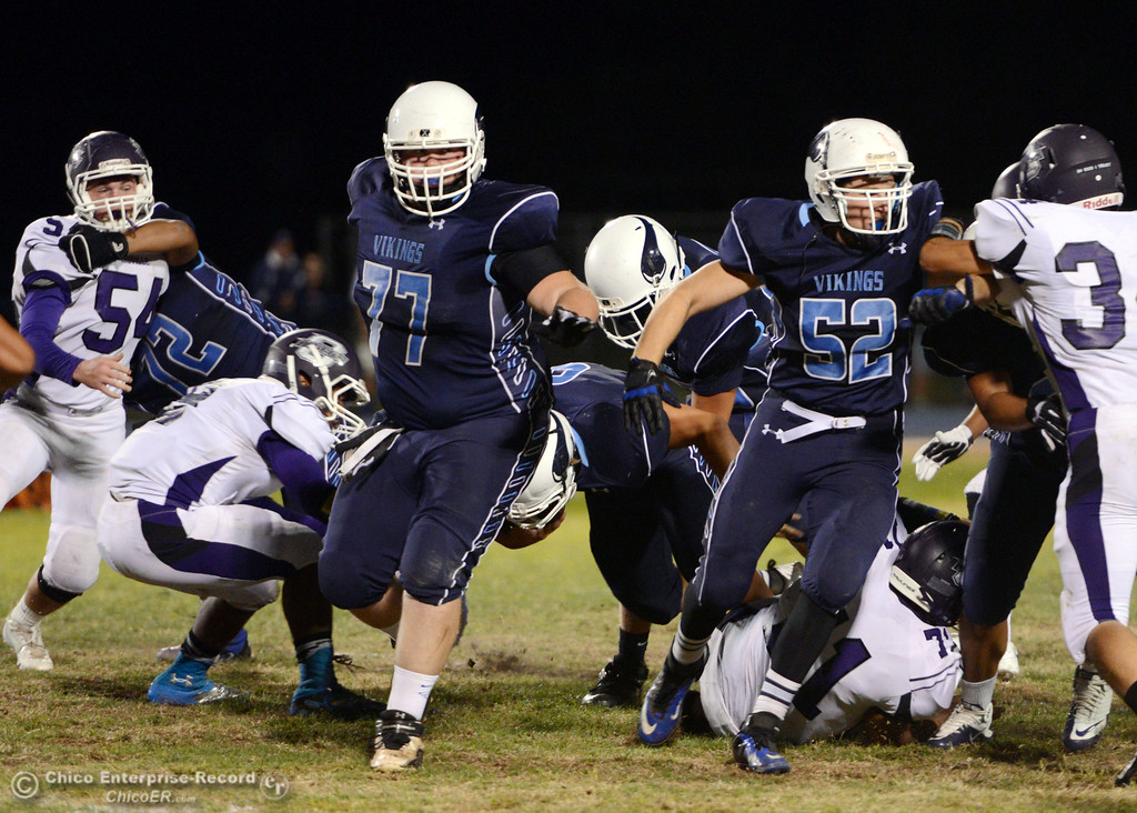 Description of . Pleasant Valley High\'s #77 Tyler Stimac (left) and #52 Riley Andrew (right) hold the line against Oroville High in the first quarter of their football game at PVHS Asgard Yard Friday, September 20, 2013, in Chico, Calif. (Jason Halley/Chico Enterprise-Record)