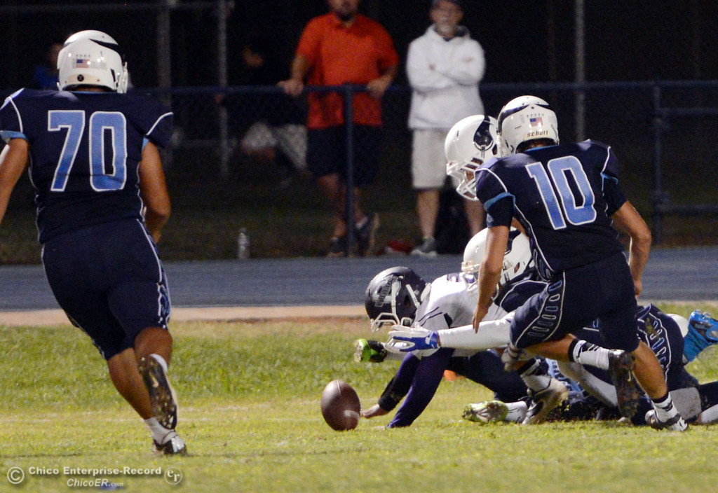 Description of . Pleasant Valley High picks up the fumble against Oroville High in the second quarter of their football game at PVHS Asgard Yard Friday, September 20, 2013, in Chico, Calif. (Jason Halley/Chico Enterprise-Record)