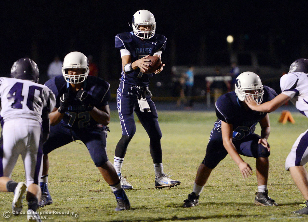 Description of . Pleasant Valley High\'s #7 Zane Ferguson drops back to pass against Oroville High in the second quarter of their football game at PVHS Asgard Yard Friday, September 20, 2013, in Chico, Calif. (Jason Halley/Chico Enterprise-Record)