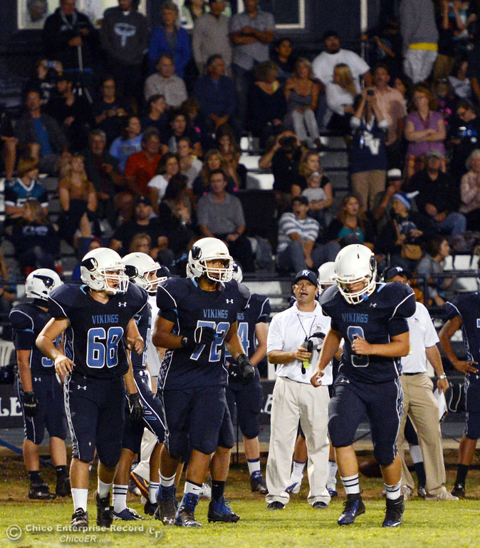 Description of . Pleasant Valley High\'s #68 Jacob Gregg, #72 Christian Darden coach Mark Cooley and #9 Houston McGowan (left to right) against Oroville High in the third quarter of their football game at PVHS Asgard Yard Friday, September 20, 2013, in Chico, Calif. (Jason Halley/Chico Enterprise-Record)