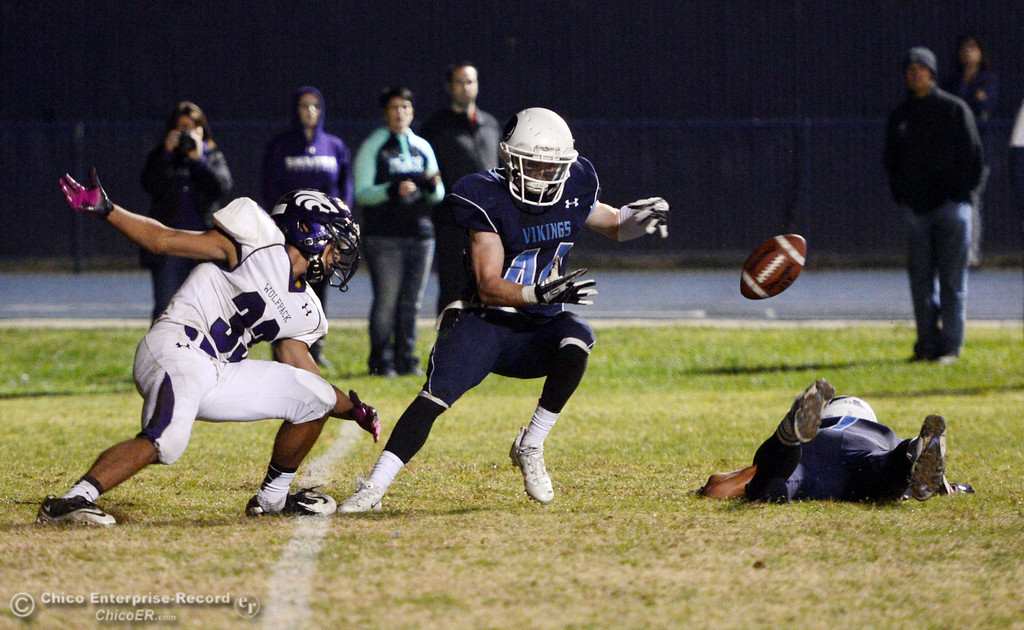 Description of . Pleasant Valley High\'s #7 Zane Ferguson (right) and #42 Chad Olsen (center) break up a pass intended for Shasta High\'s #33 Mario Valdez (left) in the fourth quarter of their football game at PVHS Asgard Yard Friday, October 18, 2013 in Chico, Calif.  (Jason Halley/Chico Enterprise-Record)