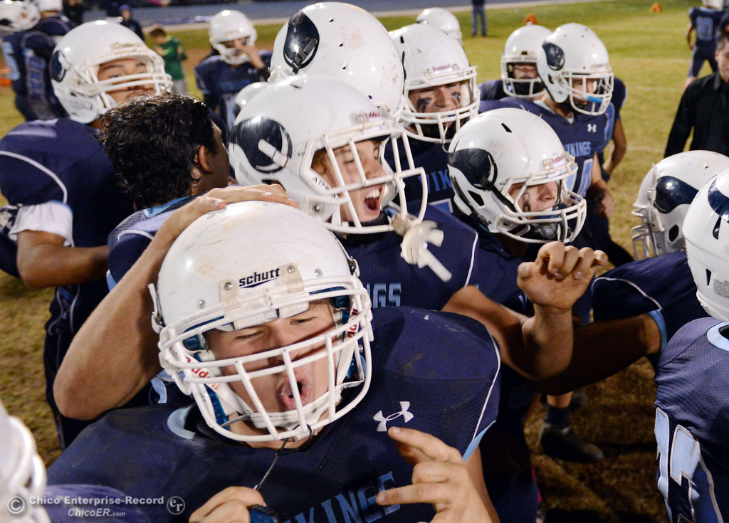 Description of . Pleasant Valley High celebrates their win against Shasta High in the fourth quarter of their football game at PVHS Asgard Yard Friday, October 18, 2013 in Chico, Calif.  (Jason Halley/Chico Enterprise-Record)