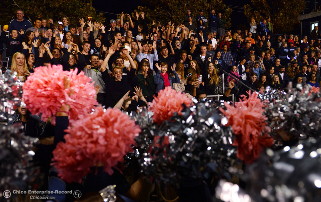 Description of . Pleasant Valley High fans cheer on against Shasta High in the second quarter of their football game at PVHS Asgard Yard Friday, October 18, 2013 in Chico, Calif.  (Jason Halley/Chico Enterprise-Record)