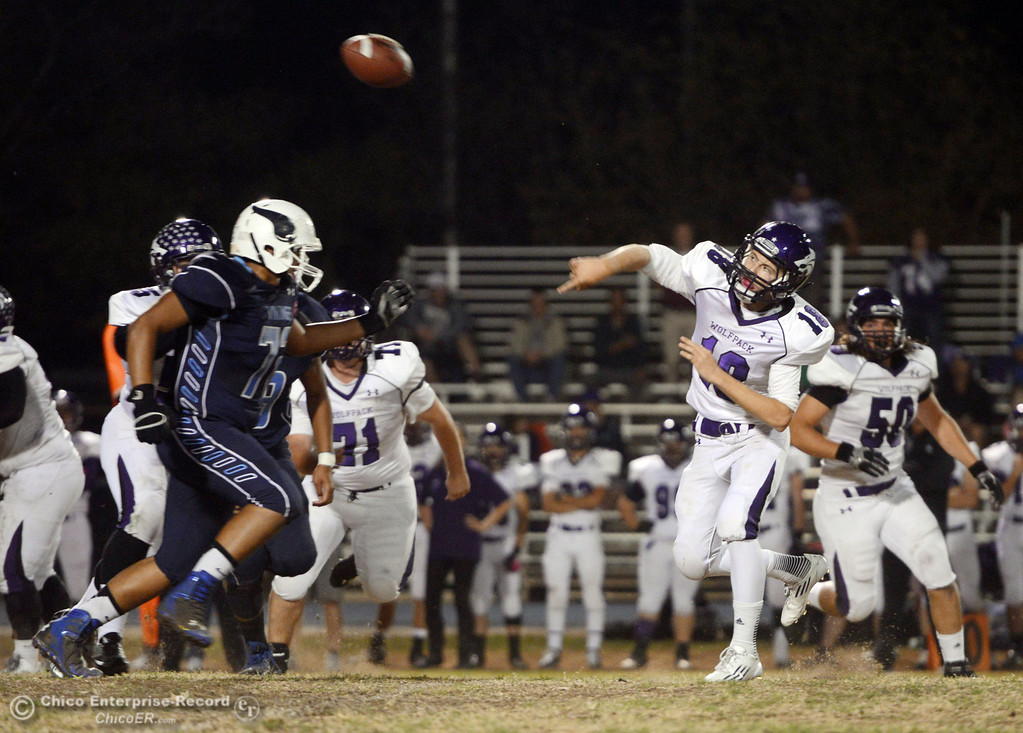 Description of . Pleasant Valley High\'s #72 Christian Darden (left) pressures against Shasta High\'s #18 Bailey Odell (right) in the first quarter of their football game at PVHS Asgard Yard Friday, October 18, 2013 in Chico, Calif.  (Jason Halley/Chico Enterprise-Record)
