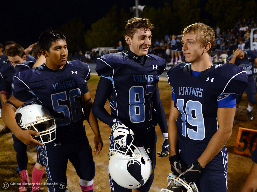 Description of . Pleasant Valley High\'s #56 Zariel Torres, #87 Jake Gildea and #19 Reece Maddox (left to right) against Shasta High in the first quarter of their football game at PVHS Asgard Yard Friday, October 18, 2013 in Chico, Calif.  (Jason Halley/Chico Enterprise-Record)