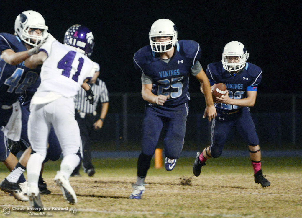 Description of . Pleasant Valley High\'s #25 Ryan Steindorf (left) blocks for #28 Dylan Batie (right) against Shasta High in the second quarter of their football game at PVHS Asgard Yard Friday, October 18, 2013 in Chico, Calif.  (Jason Halley/Chico Enterprise-Record)