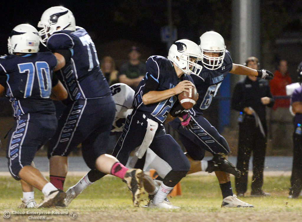 Description of . Pleasant Valley High\'s #12 Trent Darms (center) rushes against Shasta High in the first quarter of their football game at PVHS Asgard Yard Friday, October 18, 2013 in Chico, Calif.  (Jason Halley/Chico Enterprise-Record)