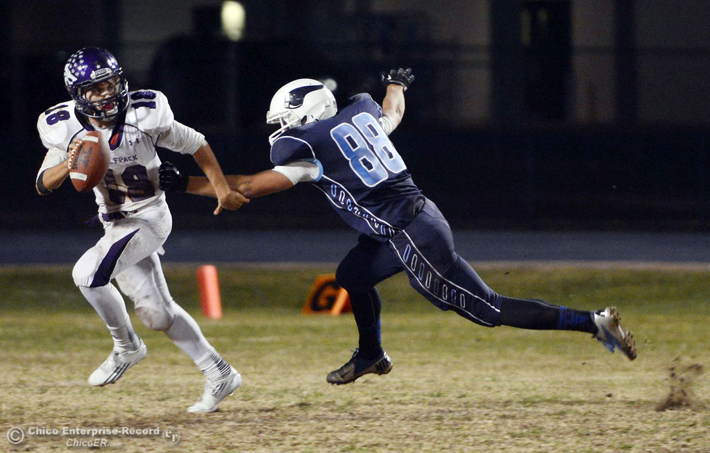 Description of . Pleasant Valley High\'s #88 Zack Suttles (right) pressures against Shasta High\'s #18 Bailey Odell (left) in the second quarter of their football game at PVHS Asgard Yard Friday, October 18, 2013 in Chico, Calif.  (Jason Halley/Chico Enterprise-Record)