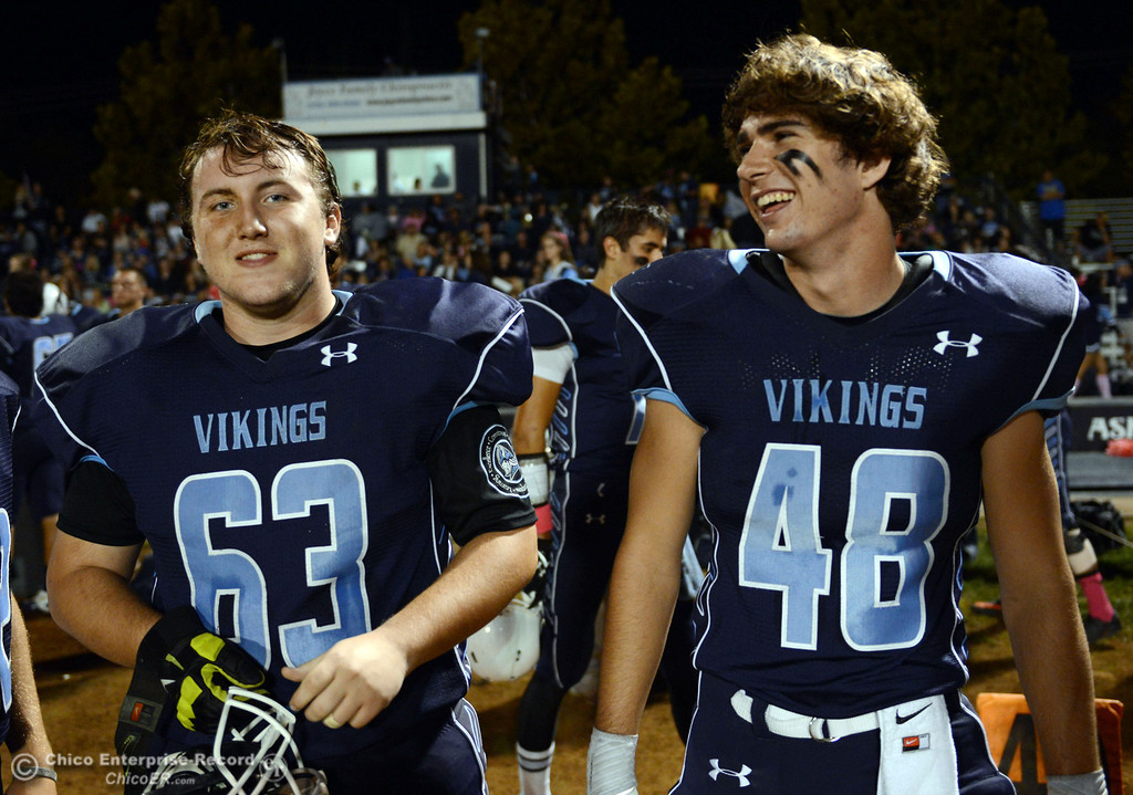 Description of . Pleasant Valley High\'s #63 Harrison Carter (left) and #48 Logan O\'Sullivan (right) against Shasta High in the first quarter of their football game at PVHS Asgard Yard Friday, October 18, 2013 in Chico, Calif.  (Jason Halley/Chico Enterprise-Record)