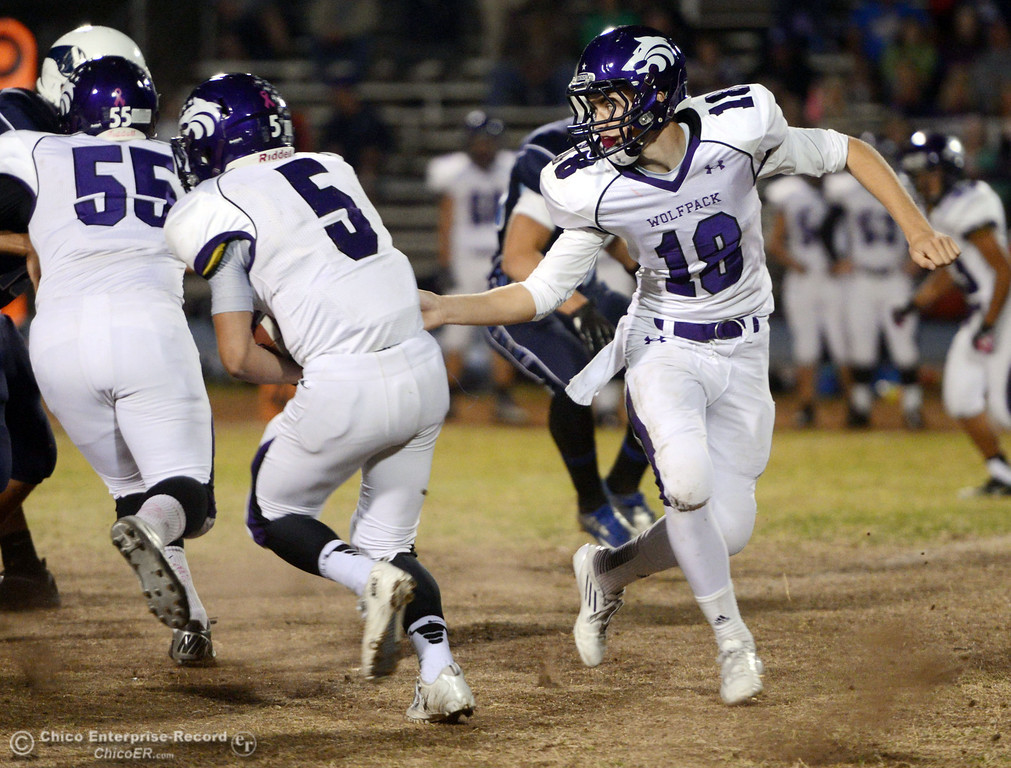 Description of . Shasta High\'s #18 Bailey Odell (right) hands off to #5 Jake Callaway (left) against Pleasant Valley High in the first quarter of their football game at PVHS Asgard Yard Friday, October 18, 2013 in Chico, Calif.  (Jason Halley/Chico Enterprise-Record)