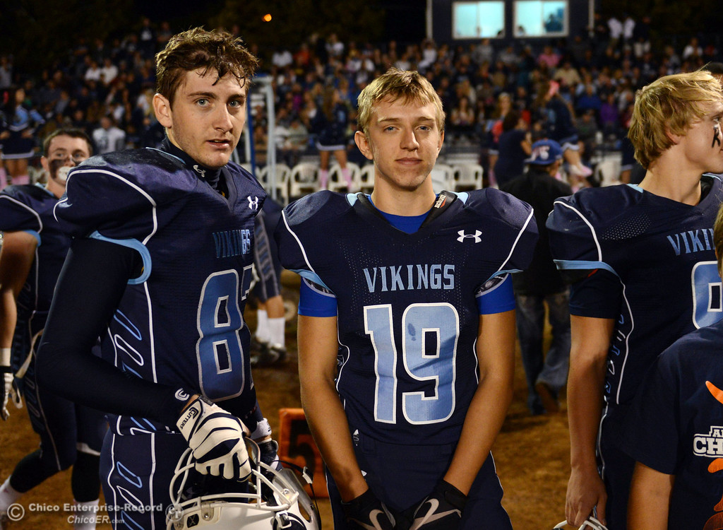 Description of . Pleasant Valley High\'s #87 Jake Gildea (left) and #19 Reece Maddox (right) against Shasta High in the first quarter of their football game at PVHS Asgard Yard Friday, October 18, 2013 in Chico, Calif.  (Jason Halley/Chico Enterprise-Record)