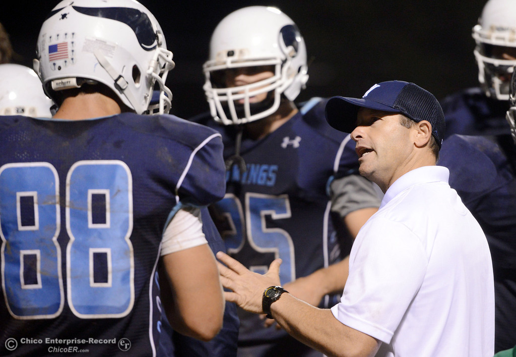 Description of . Pleasant Valley High coach Mark Cooley (right) talks to #88 Zack Suttles (left) against Shasta High in the fourth quarter of their football game at PVHS Asgard Yard Friday, October 18, 2013 in Chico, Calif.  (Jason Halley/Chico Enterprise-Record)