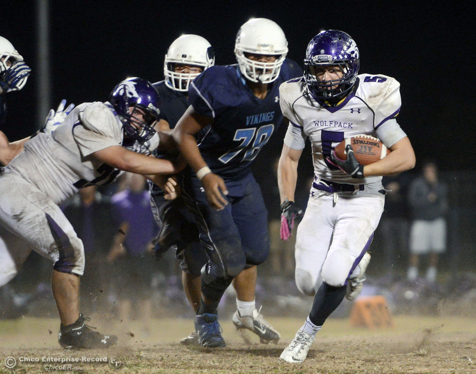 Description of . Pleasant Valley High\'s #78 Alex Marquez (back) defends against Shasta High\'s #5 Jake Callaway (right) in the fourth quarter of their football game at PVHS Asgard Yard Friday, October 18, 2013 in Chico, Calif.  (Jason Halley/Chico Enterprise-Record)