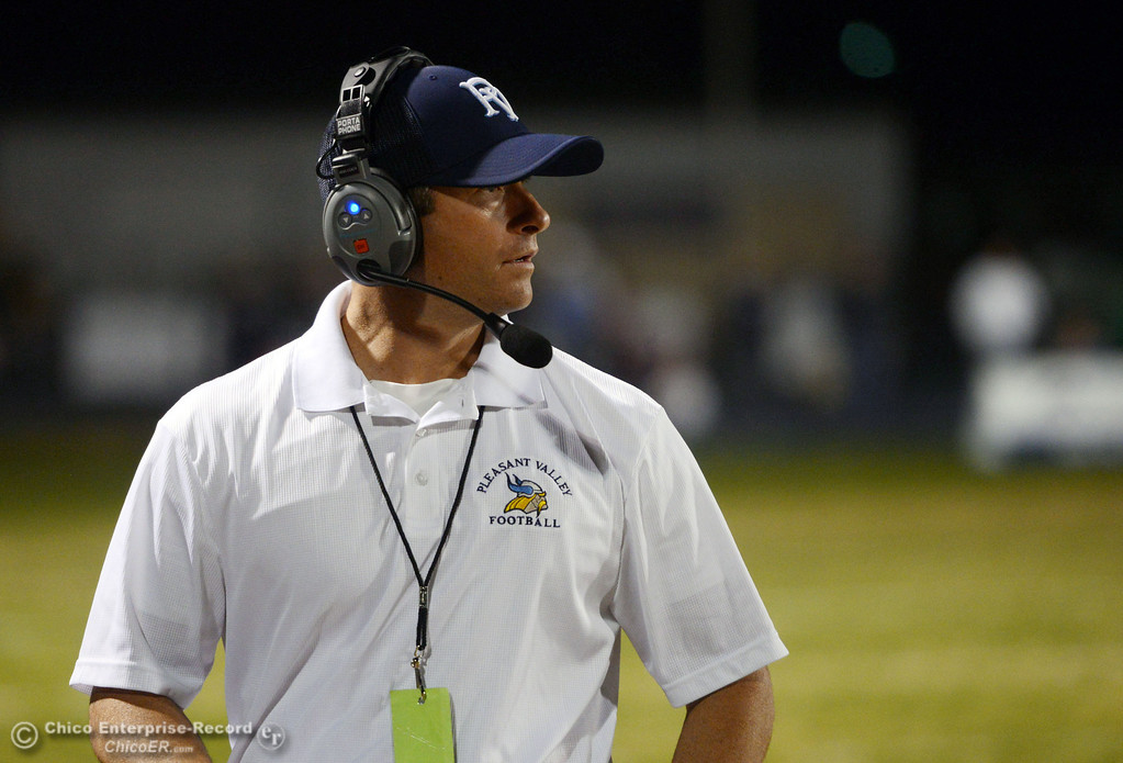 Description of . Pleasant Valley High head coach Mark Cooley looks on against Shasta High in the first quarter of their football game at PVHS Asgard Yard Friday, October 18, 2013 in Chico, Calif.  (Jason Halley/Chico Enterprise-Record)