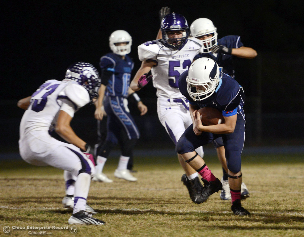 Description of . Pleasant Valley High\'s #28 Dylan Batie (right) rushes against Shasta High\'s #23 Ryan Pallato (left) in the second quarter of their football game at PVHS Asgard Yard Friday, October 18, 2013 in Chico, Calif.  (Jason Halley/Chico Enterprise-Record)