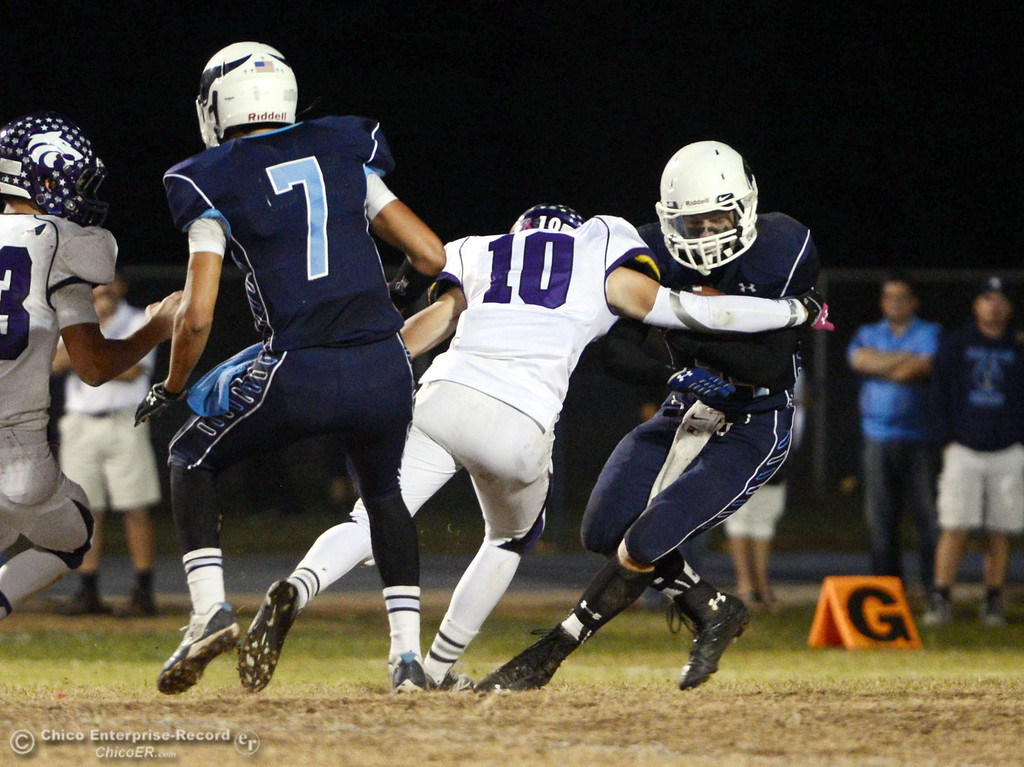 Description of . Pleasant Valley Highs\' #34 Cale Crawford (right) is tackled against Shasta High\'s #10 Noah Ferguson (left) in the second quarter of their football game at PVHS Asgard Yard Friday, October 18, 2013 in Chico, Calif.  (Jason Halley/Chico Enterprise-Record)