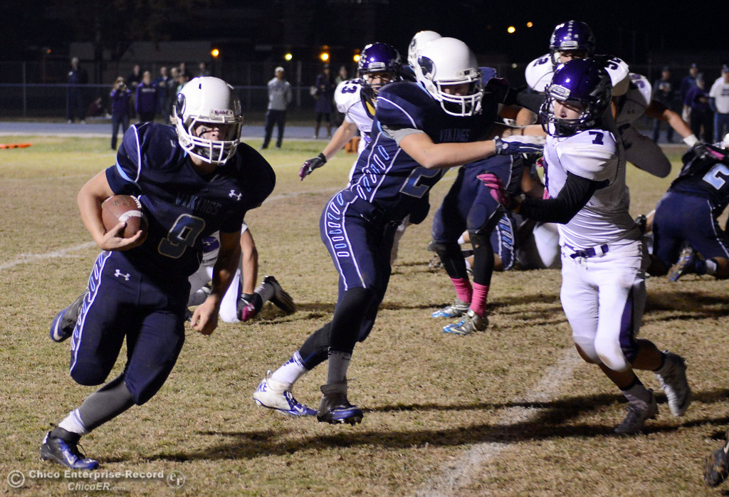 Description of . Pleasant Valley High\'s #9 Houston McGowan (left) rushes in for a touchdown against Shasta High in the first quarter of their football game at PVHS Asgard Yard Friday, October 18, 2013 in Chico, Calif.  (Jason Halley/Chico Enterprise-Record)